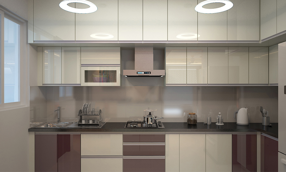 South indian kitchen interior design plays with a mix of glossy plum and cream laminates