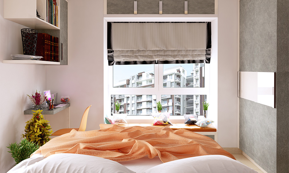 A small bedroom with a bay window seat elegant look is how to decorate a window effectively.