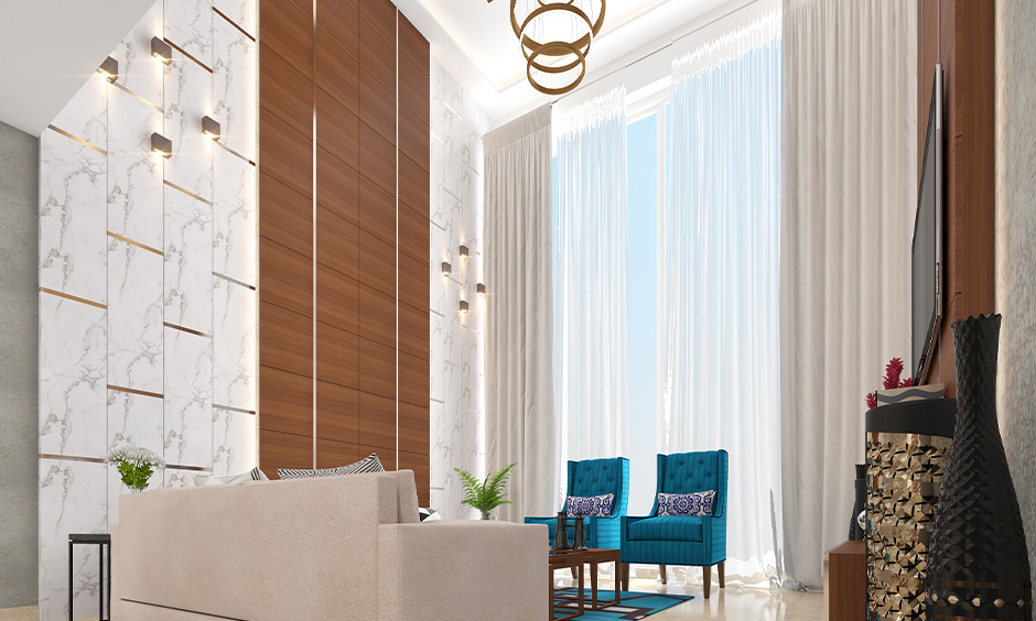 A duplex living room with a large window decorated in sheer and solid colour curtains is how to decorate a picture window.
