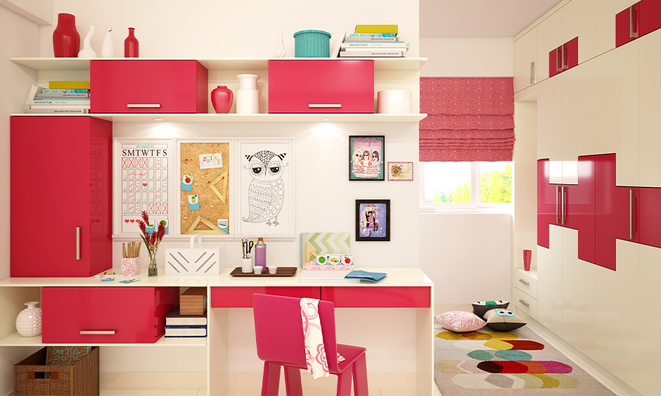 How to work from home with kids, White and pink combination workspace has bookshelves, table and chair elegantly designed.