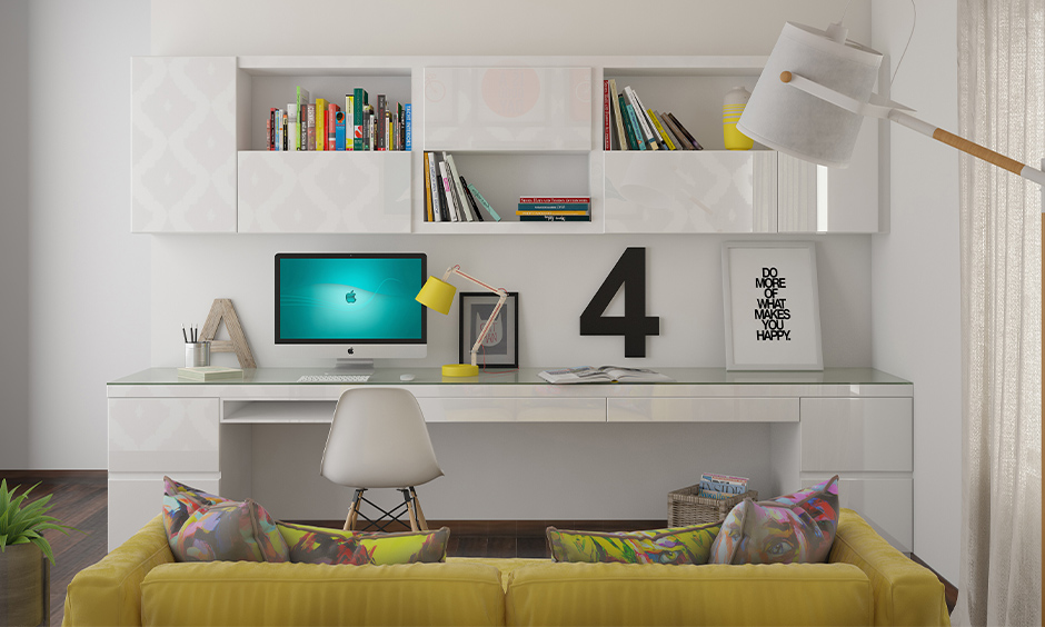 A workspace in white colour with storage shelves, table and chair sleek design, working from home with kids.