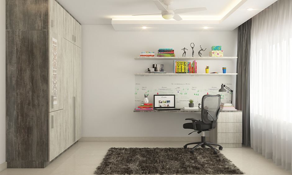 How to work from home with kids, Workspace at home has a floating table, executive chair, and wardrobe chic design.