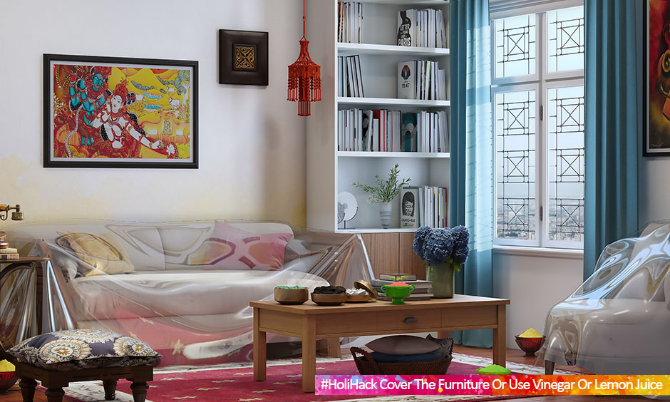 Protect living room furniture from Holi colour by covering with plastic sheets.