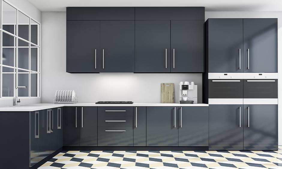 White l-shaped Indian kitchen cupboard design in black matt finish laminate look aesthetic.