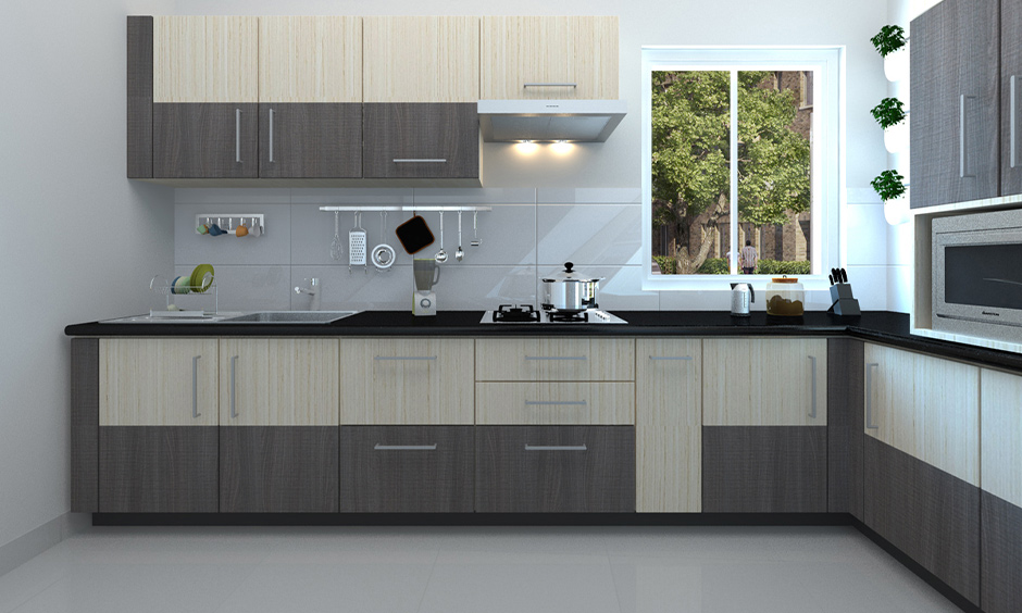 L-shaped grey Indian kitchen furniture design in brown and beige shiny laminate looks sleek.