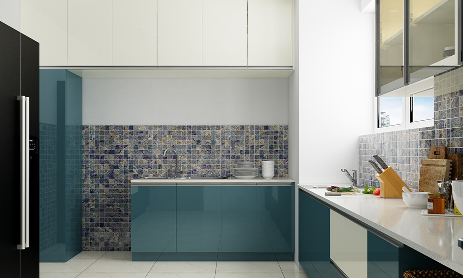 L-shaped kitchen cupboard in teal with white combination lends a calming vibe is the cupboard design for kitchen Indian home.