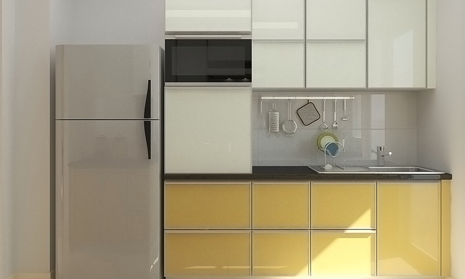 One-wall Indian kitchen cupboard design in yellow and white colour laminate brings warmth.