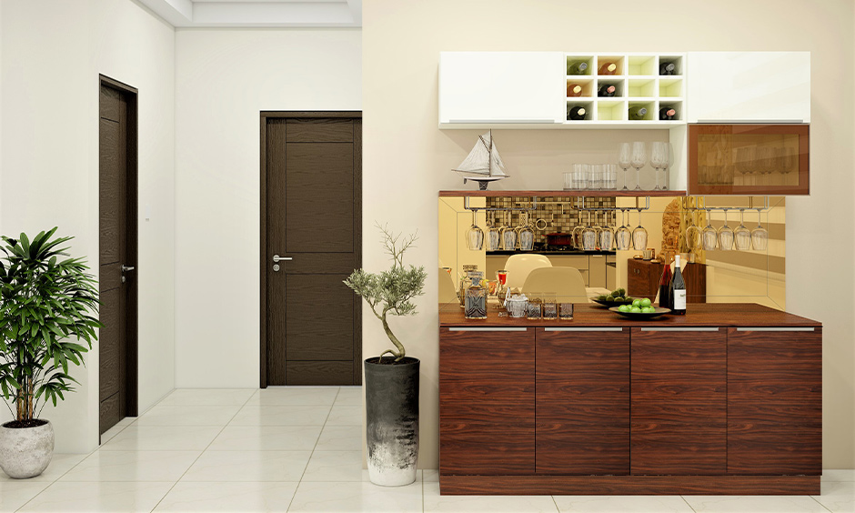 Standard cabinet wine rack design in wood with shelf for placing glasses is space-saving design.