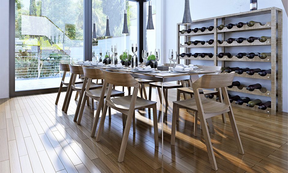 The wooden wine rack design with bigger wine bottles storage capacity in the dining area looks classy.