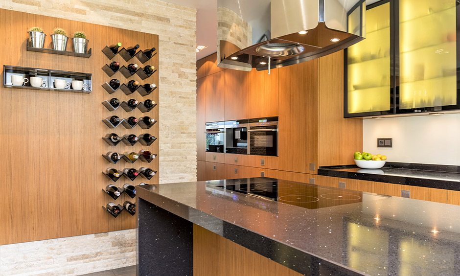 Wall-mounted designer wine rack design in island kitchen lends aesthetic to the area.