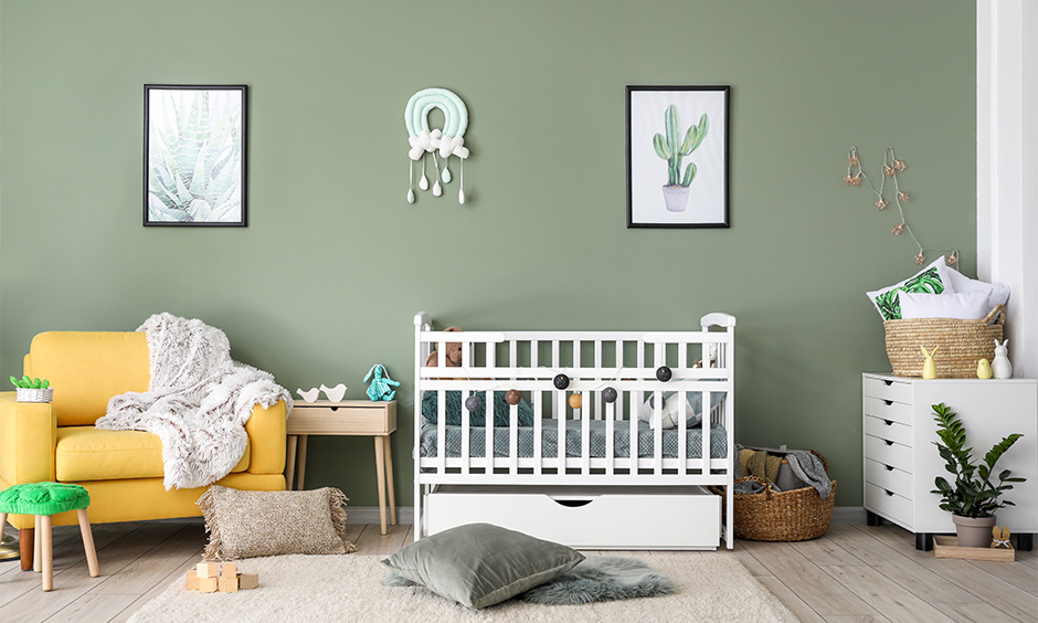 Baby boy room decorated with yellow armchair for space to comfort the baby.