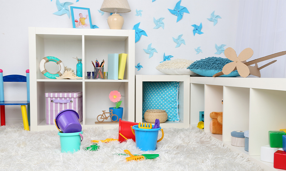 Baby room decorated with open square shelves in chic design for keeping the things.
