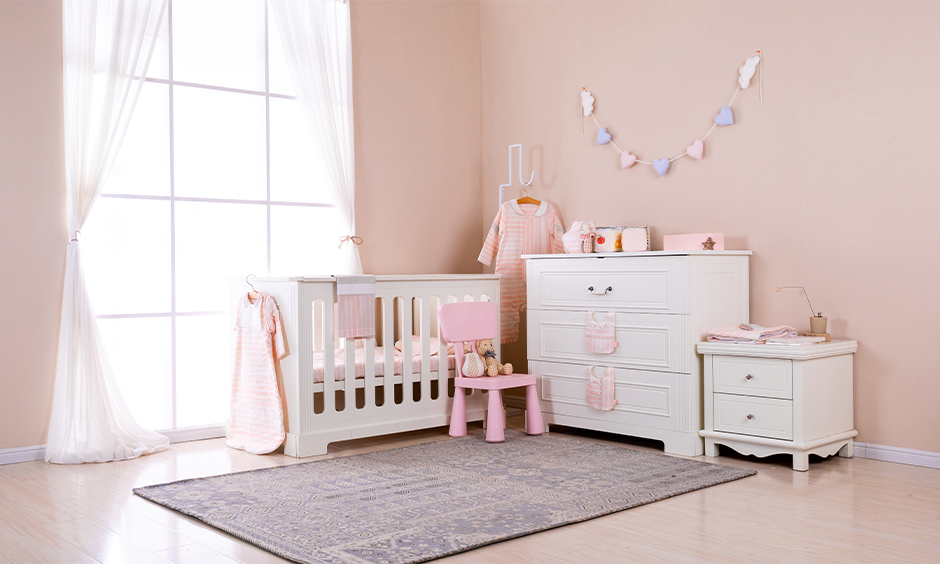 Pink baby girl room decoration with light sheer curtains lends a sleek look to the area.