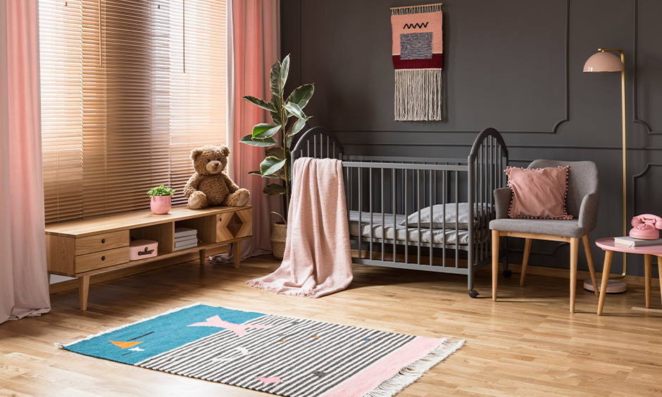 Room decoration for new born baby, the room decorated with wooden flooring and soft rugs.