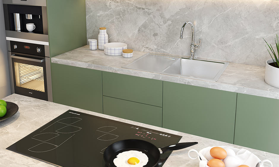 White marble countertop with contrasting colour cabinets