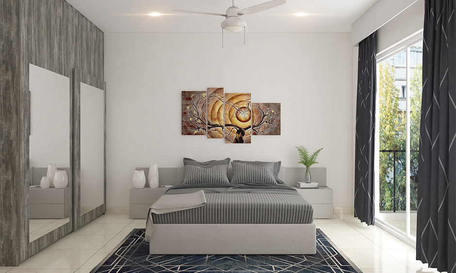 Gallery wall idea for bedroom with multiple artistic frames of different shapes and sizes above the headboard looks vibrant.