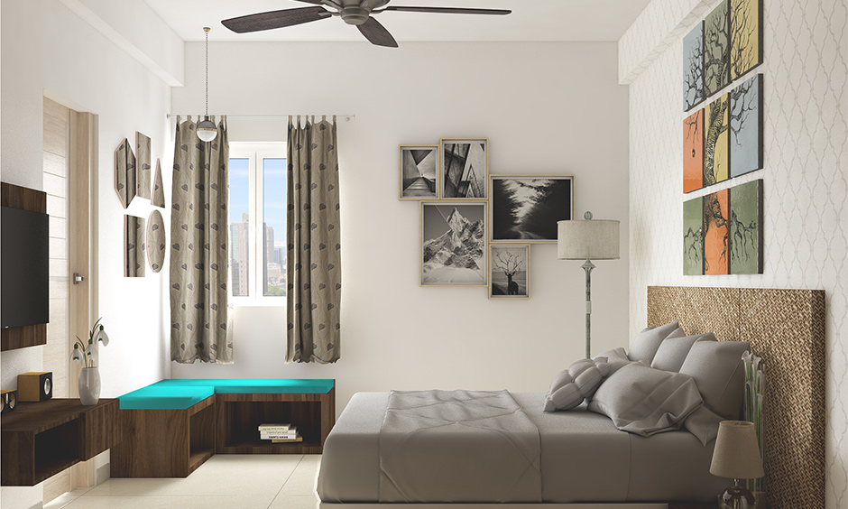 Frameless canvas prints above the headboard and photo prints on another wall are the best bedroom gallery wall idea.