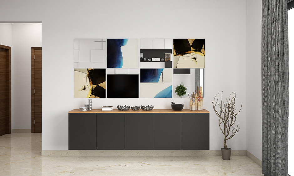 Cool gallery wall ideas, hallway wall decorated with frameless canvas prints with mirrors with an eclectic minimal look.