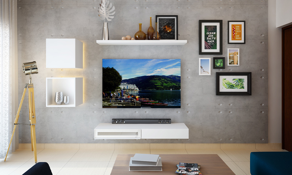 Photo gallery wall ideas, Living room with arranged prints, and photo frames around the tv unit look minimal.