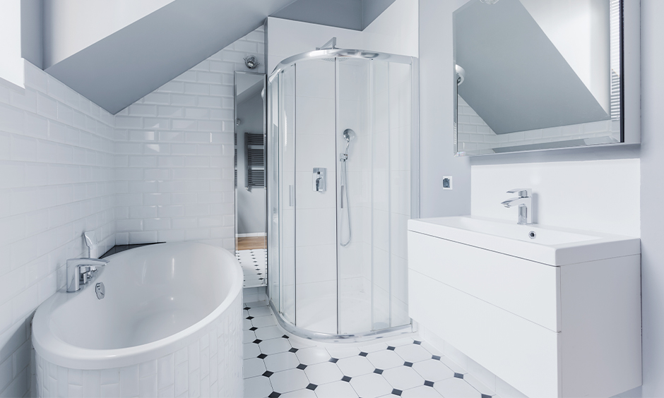 All-white bathroom simple white tiles with a hint of black are the bathroom tile design idea for small bathroom India.