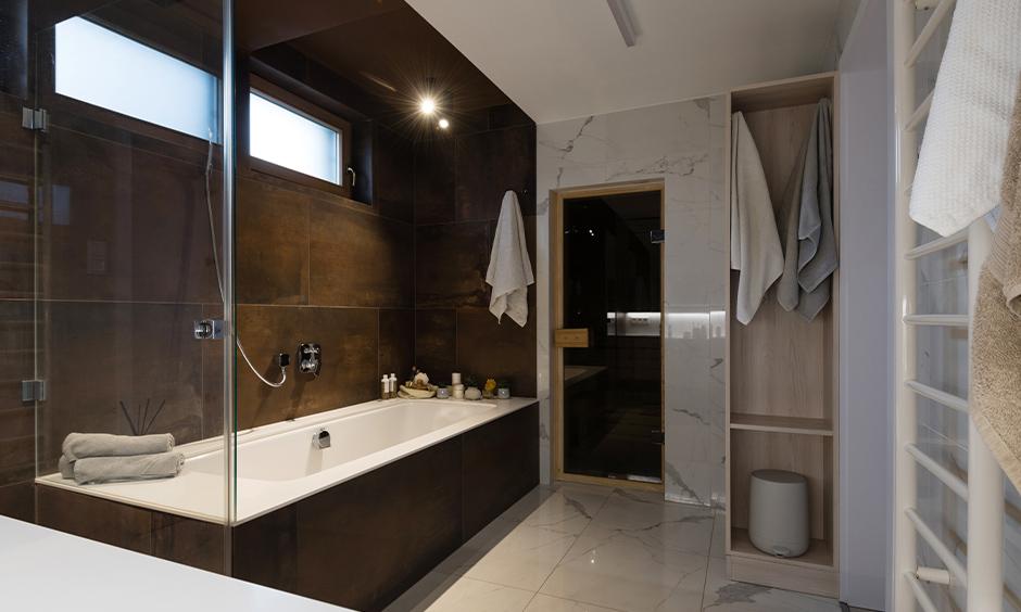 Brown and cream dual-colored big bathroom tile design idea for a small bathroom looks sleek.