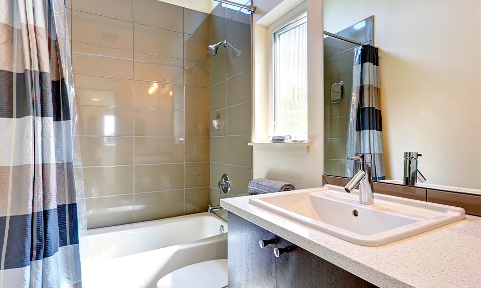 Glossy bathroom wall tiles design idea for the small bathroom looks bright and lends a modern vibe.