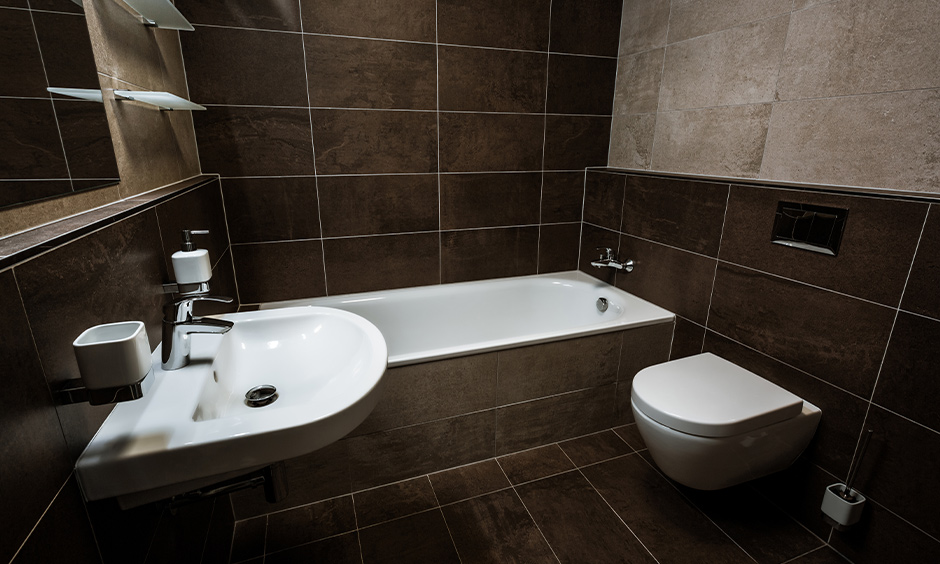 Best bathroom tile design idea for small bathroom India with floor and walls have large single-colored brown tiles.