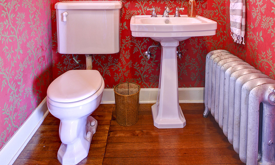 Bathroom floor tile design idea for small bathroom in wooden porcelain with red-colored wallpaper wall look bold.