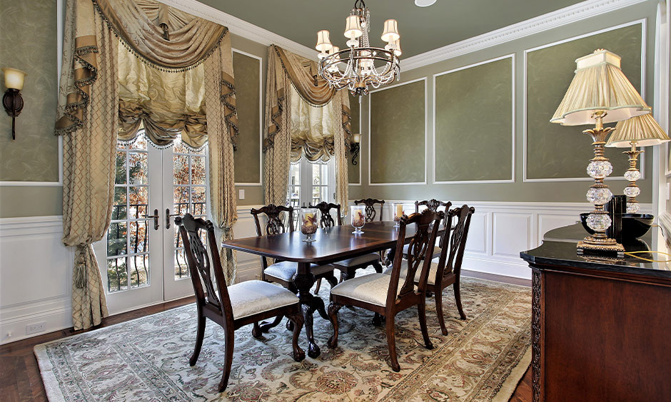 Classic french interior design dining room with chandelier and fancy drapes look classy.