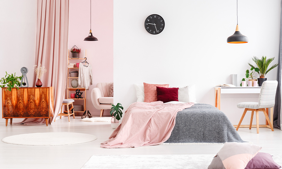 The white color combination for the pink wall will add an element of elegance and luxury to the bedroom.