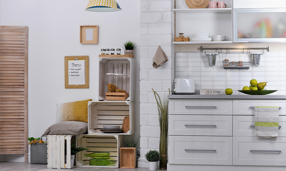 DIY kitchen cabinet storage idea, White kitchen has cabinets made from unused wooden crates and stack on top of the other.