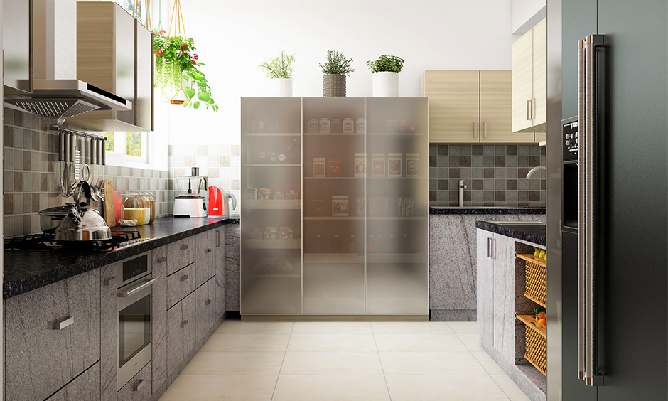 A tall kitchen cabinet storage idea with a translucent glass door in the parallel kitchen looks minimal.