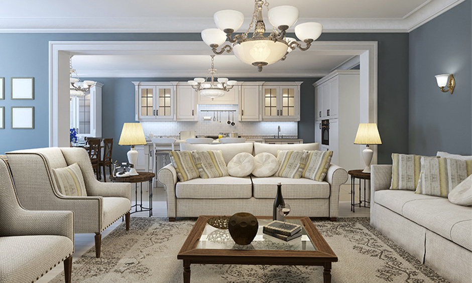 Grey and white home colour matching in the living room with a beige fabric sofa set look classic.