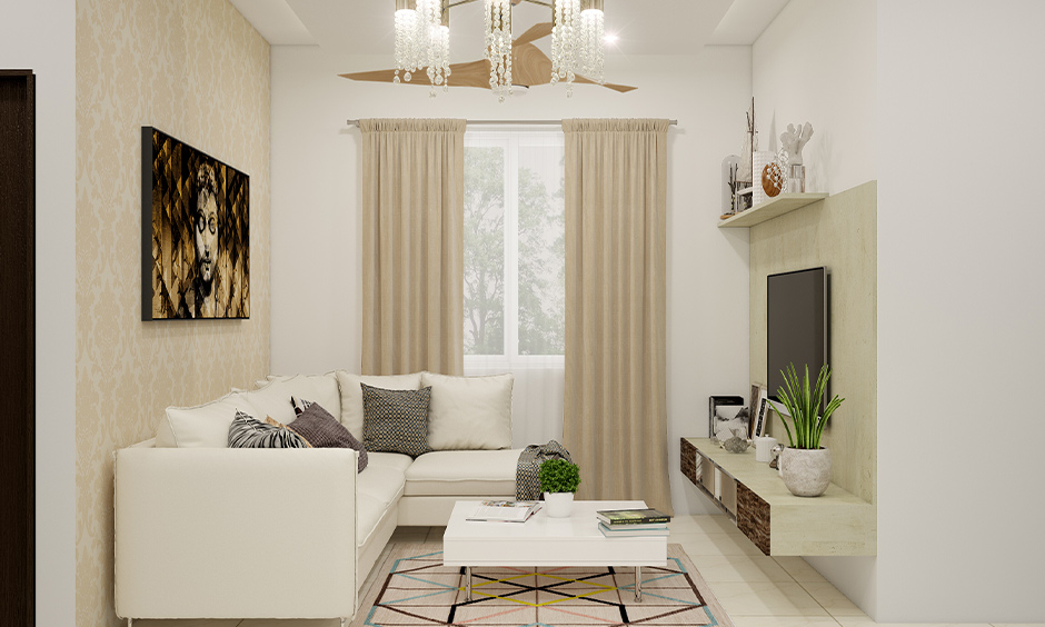 Small living room in beige and white matching colour schemes home with a white fabric lounger couch look aesthetic.