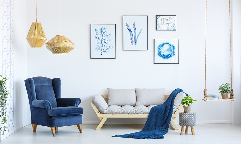Small white living room matching colour schemes home with a pop of blue elements look minimal.