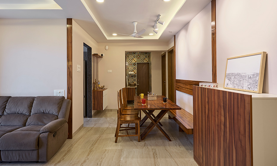 The earthy dining area by best interior designer in navi mumbai