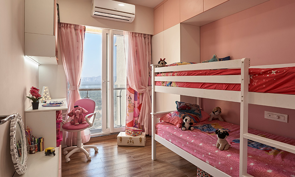 The pastel pink kids bedroom by interior design firms in navi mumbai