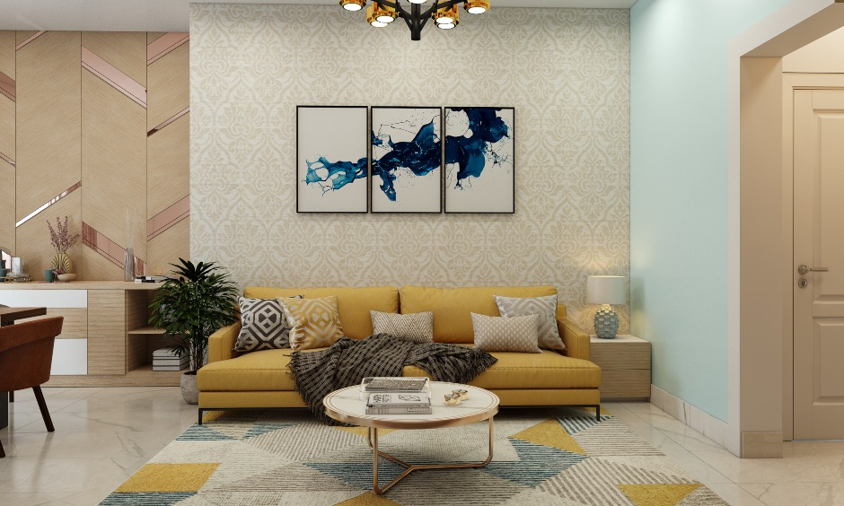 1bhk home design with yellow sofa and dull gold wallpaper