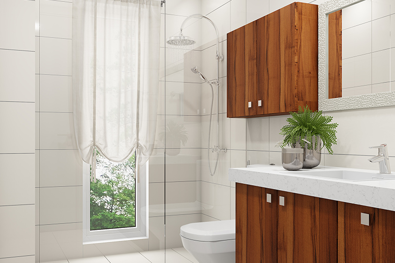 Bathroom renovation with white porcelain tiles, a thick-glass divider and wooden cabinets looks sleek.
