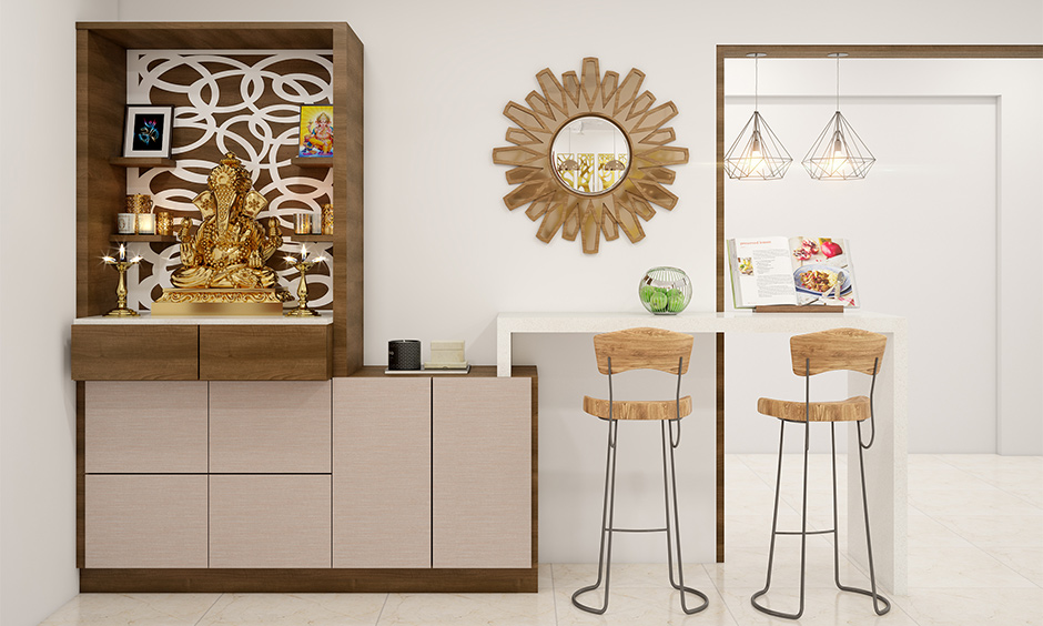Compact pooja room placed at the corner with minimal design is the cupboard design for the pooja room.