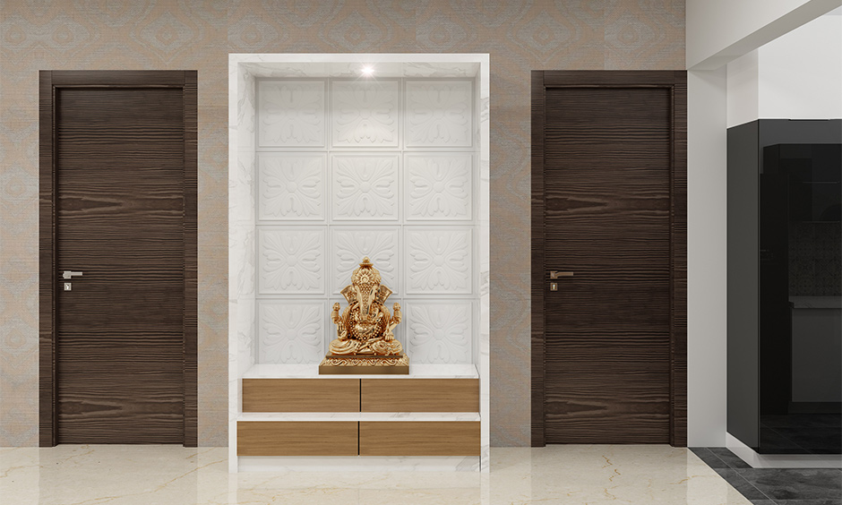 Pooja room with simple wooden cupboard design and clean look is the cupboard design for pooja room.