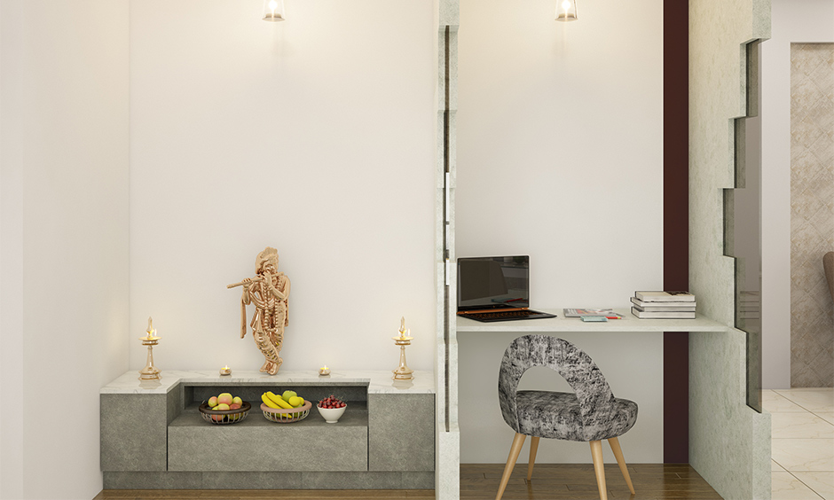 Pooja room cupboard design with smart storage is the best space-saving pooja room design.