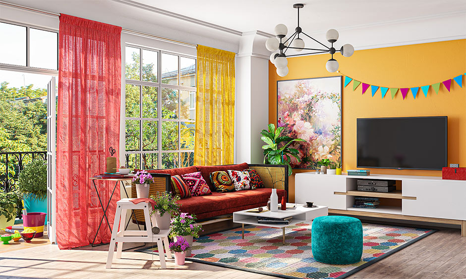 Ugadi decoration in living room with colourful curtains, sofa covers and vibrant cushions decoration adds a festive vibe.