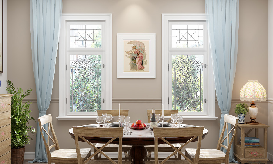 The dining room has a modern popular window grill design in floral lends an industrial look.