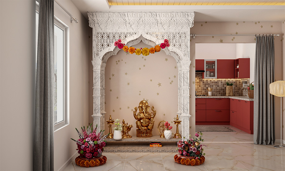 Jaali marble pooja room design from ceiling to floor with intricate carvings exudes a celestial vibe.