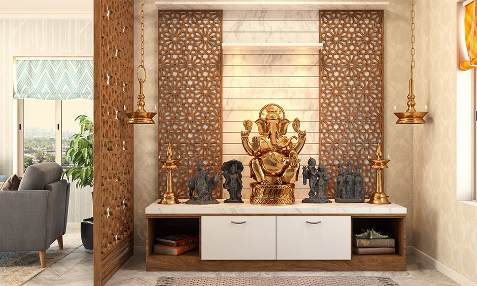 Pooja room design with marble top and wooden drawers is simple yet highly alluring.