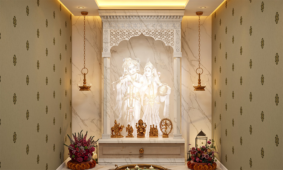 White Italian marble mandir design for home with a decorative lit wall panel adds a blissful charm to the area.