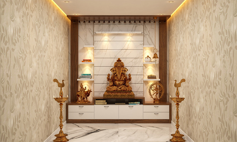 Marble pooja mandir design for home with intricate carvings and motifs enhance the look of the area.