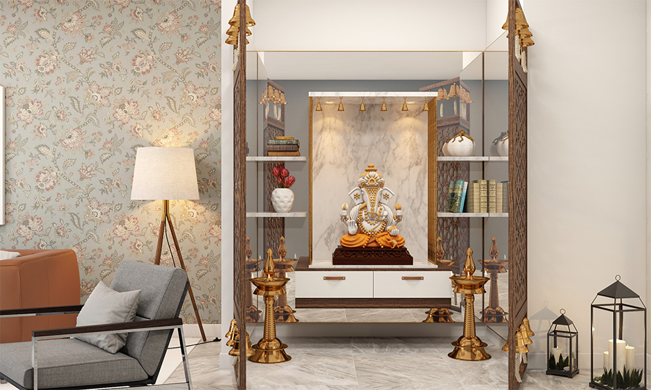 Wall-mounted marble pooja room design for home with mirrors behind the wall-mounted adds a classic look.