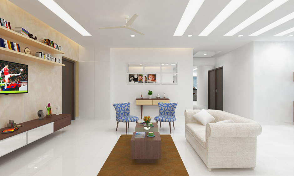 Porcelain white tiles for living room with glossy finish lends an elegant look to space.